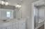 master bath with double vanity with separate shower & soaking tub