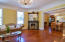 Beautiful hardwood floors in parlor and original fireplace with views into dining room.