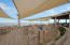 Dining deck at Pelican's Nest, drinks by the sea and short order food.