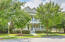 This gorgeous Charleston home offers double porches, mature trees and lots of curb appeal.