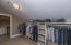 1 of 2 closets in master with laundry room 1 of 2.