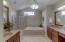 Master bath boasts modern fixtures and dual vanities