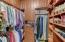 Custom built walk-in closets make organization a breeze.
