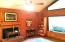 Check out the den featuring cathedral ceiling , wood burning fireplace and beautiful wood walls.