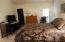 Spacious master bedroom featuers large walk in closet and access to back yard..