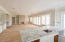 Full length view of great room from kitchen through dining area to the living area...windows and sliders with gorgeous views