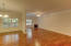 Another view of this open concept floor plan with gleaming wood floors.