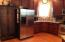Refrigerator and tall storage cabinet