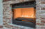 Remote control ribbon gas fireplace with adjustable flame height and black reflecting crackle crushed glass