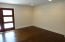 Great room/living room area with custom shiplap wall treatment.