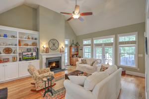 Family room with soaring ceilings, built-ins and a fireplace