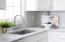 Beautiful Quartz countertops throughout the updated kitchen.