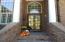 Brick Home with Stoop and beautiful front door.