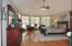 Master Bedroom with bay window, hardwood floors, slider to brick porch, Casablanca fan and walk in closet.