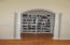 Custom book shelves with columns, & coat closet as you enter master bedroom.