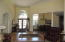 Foyer with custom light fixture, hardwood floors and more.