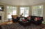 Great room with beautiful windows.