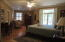 Guest Bedroom with sitting area, walk in closet and brick private patio.