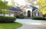 Custom Home with 3 Car Garage, gas lanterns and plenty of space to turn around.