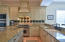 Beautiful granite counters with loads of space along with center prep-island.