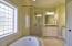 Main floor Master bath with Jacuzzi tub.