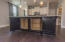 Plenty of cabinet space in kitchen island.
