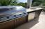 2916 Palm Blvd Professional grade outdoor 5 burner gas grill with fridge and sink.