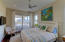 Second bedroom has direct access to the wrap around screened in porch with direct beach views.