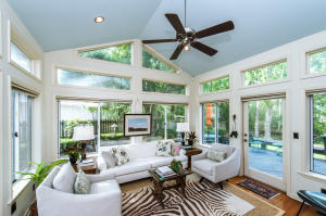lovely sunroom adorn with stunning tall windows and flanked by two private custom wooden decks