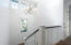 Abundant Light in Staircase with Beautiful Light Fixture.
