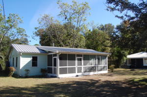 House sits on large, open lot.