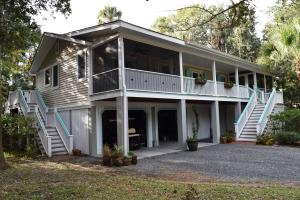 Beautiful island cottage elevated for ample storage underneath in garage and minimizing flood insurance costs!