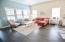 Abundant natural light in the living room and 11 foot ceilings.