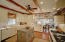 KITCHEN OPENS TO CASUAL DINING AREA
