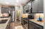 Stainless appliances and paneled cabinet doors.
