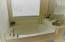 Master Bath offers garden tub and separate shower
