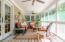 Screened porch perfect for entertaining or just relaxing.
