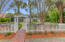 A serene gated entry welcomes you to 2808 Atlantic Ave.