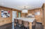 Hand milled Pecky Cypress wood encloses the dinning room