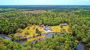 Just a few miles from Middleton and Magnolia Plantations in Summerville's historic district, this absolutely one of a kind property is one you must see to believe. A gated entry leads down a long tree lined driveway until you reach the nearly 5000 sqft home that beautifully sits on the Ashley River with a boat ramp and dock. The home features very comfortable accommodations, an elevator and an approximately 1100 sqft in-law suite on the ground level. If you are a car enthusiast or need a gigantic space to explore your passion, the 6000 sqft detached garage is like one you've never seen before, there's even an airplane hanging from the ceiling! A full front porch looks out the lush yard and water while the back deck overlooks the salt water pool. There is something for everyone at this property, DO NOT MISS OUT  Additional features include:  -32+ acres -6000 sq ft detached hobby shop garage -Horses are allowed -Power boxes located every 500 feet down the driveway -Three septic systems throughout the property, plenty of room for other outbuildings   -A 2nd huge detached garage is on the property -In-law suite includes separate entrance, full kitchen, full bath, bedroom, living room and office -Eat-in kitchen has plenty of counter spaces, cabinets and views of the water -Living room has soaring cathedral ceiling with fireplace and built-ins -Hardwood floors -Master bedroom has a tray ceiling, two full baths, a walk-in closet and access to a sitting room -10 car attached garage  Book your showing today!