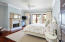 Master Bedroom with french doors to terrace/porch with water views.