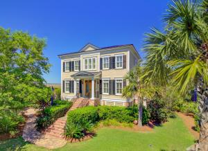 Beautiful expansive front yard and upgraded paver driveway greets your guests