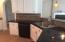 Kitchen has Tiled Backsplash & Slate Flooring