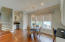 A breakfast area and drink bar with wine cooler complete this open living space.