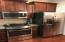4 Burner Slide-in Gas Range, Built-in Microwave, Dishwasher, and Side-By-Side Full-Size Refrigerator!