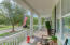 Spacious front porch overlooking greenspace!