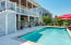 Nice size pool, outdoor kitchen, several sitting areas off the pool
