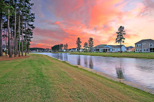 Breathtaking lake views in Four Seasons at The Lakes of Cane Bay, a 55plus/active adult community with newly completed amenity center that is out of this world! Light, bright, open, and airy! This Ravenna model built in 2017 has everything that today's buyer is seeking in a new home. Open-concept living featuring 2 bedrooms, 2.5 baths, office, sunroom, screened lanai, and side entry 2 car garage. As you approach the home you will immediately notice the stately brick detail, full front porch, and cheerful landscaping. Upon entering, a defined foyer highlighted with a tray ceiling and cottage trim package that carries throughout the entire home. The upgrades continue from there. A chef's kitchen with the builders highest level of upgrades including double wall ovens, 36'' gas cooktop, Quartz