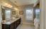 Master Bath feature dual vanities, tile flooring, and granite countertops