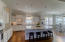 A chef's kitchen with upgraded, white cabinets and light, granite countertops